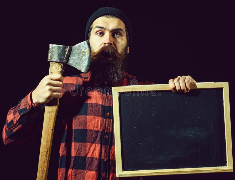 Man with axe and chalkboard royalty free stock images