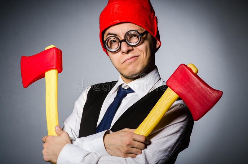 Man with axes. In funny concept royalty free stock photography