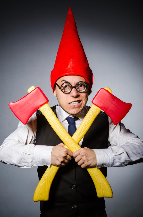 Man with axes. In funny concept royalty free stock image