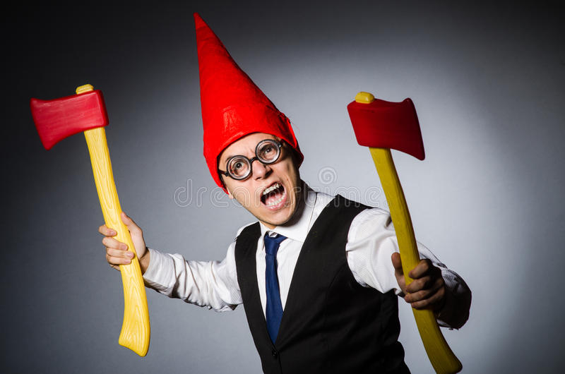 Man with axes. In funny concept stock photography