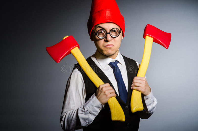 Man with axes. In funny concept royalty free stock images
