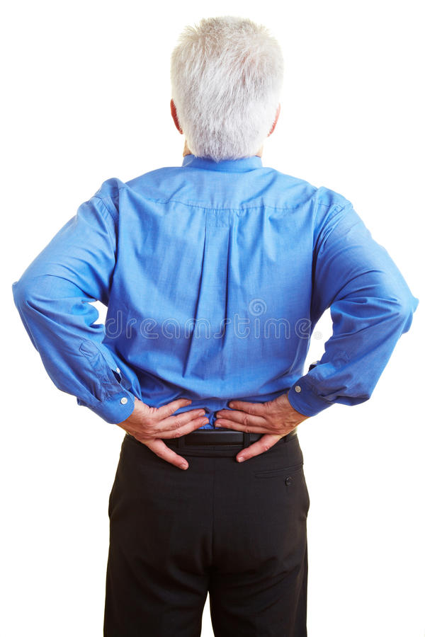 Man with back problems. Senior citizen holding his hands on his aching back stock photo
