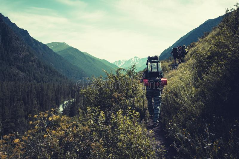 Man with backpack hiking in mountains Travel Lifestyle success concept adventure active vacations outdoor mountaineering sport stock photo