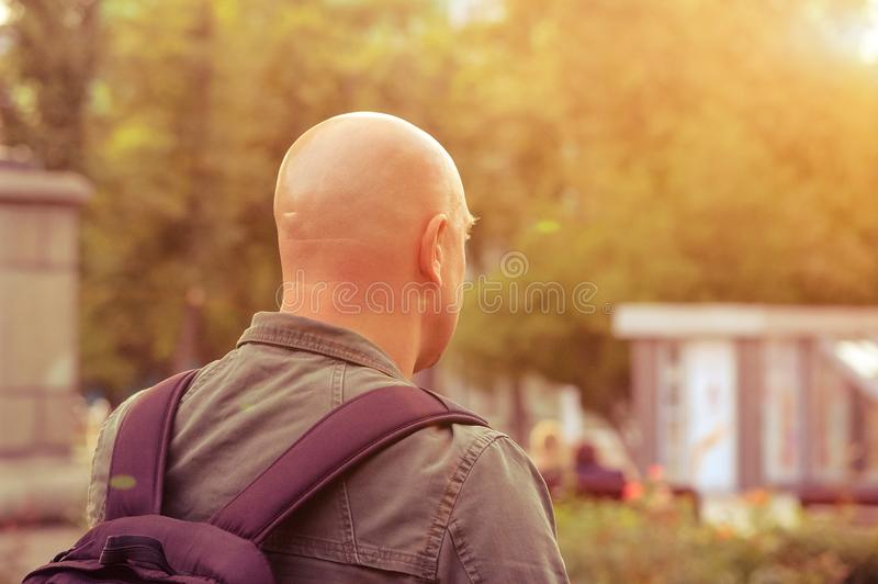 A man with a backpack looking into the distance , concept of traveling stock photos