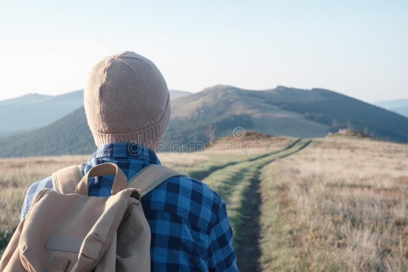 Man with backpack on mountains road royalty free stock images
