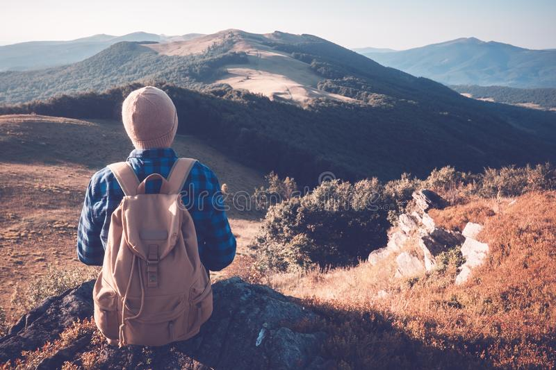Man with backpack on mountains road royalty free stock photos
