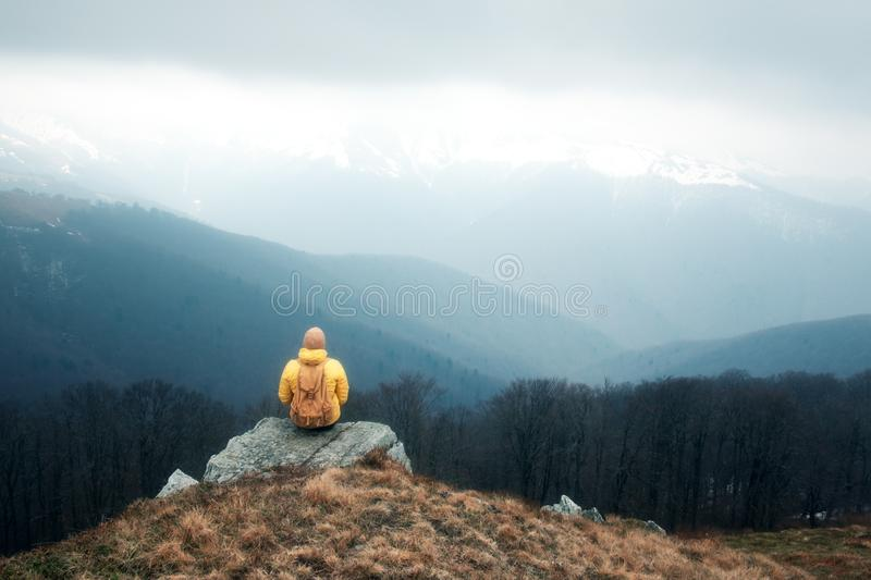 Man with backpack in spring mountains. Travel concept. Landscape photography stock photography