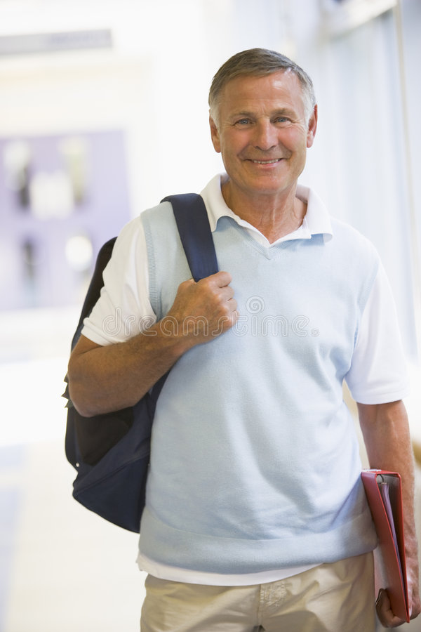 Download A Man With A Backpack Standing In A Corridor Stock Photo - Image: 6080604