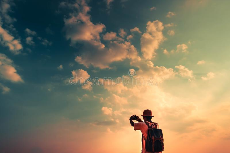 Man with backpack and taking photo sky in sunset. concept for adventure and travel  in summer vacations and outdoor alonePhang Nga stock photos