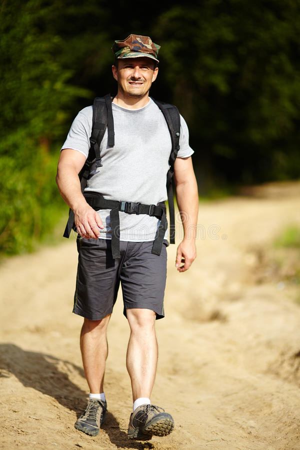Man with backpack stock image