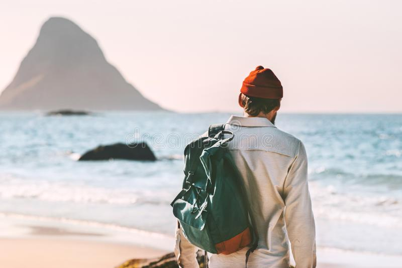 Man with backpack walking at ocean beach summer royalty free stock image