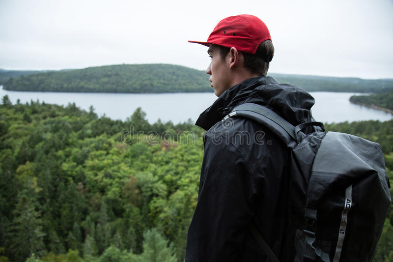 Man with backpack in woods royalty free stock photography