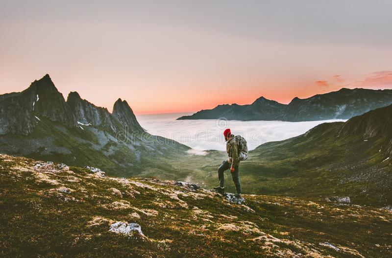 Man backpacker hiking in mountains alone outdoor royalty free stock photography