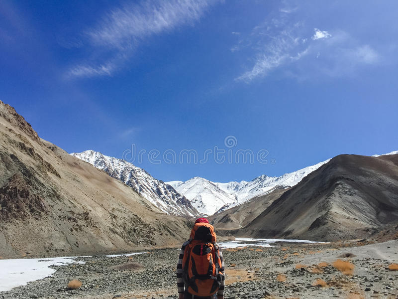 Man backpacker traveling hiking in mountains Travel Lifestyle success concept adventure active summer vacations outdoor. royalty free stock image