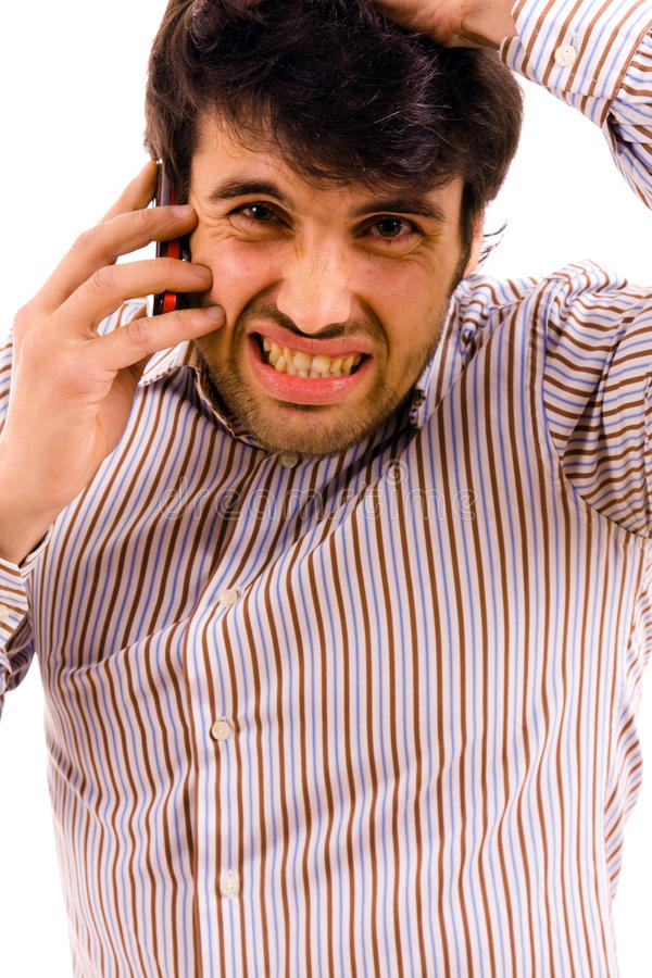 Man with bad news. Young man with bad news on his cell phone stock image