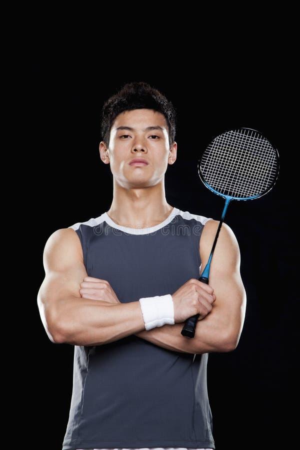 Man with badminton racket, portrait stock image