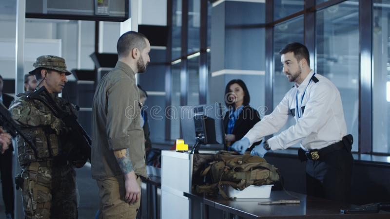 Man transitting weapon standing in airport royalty free stock images
