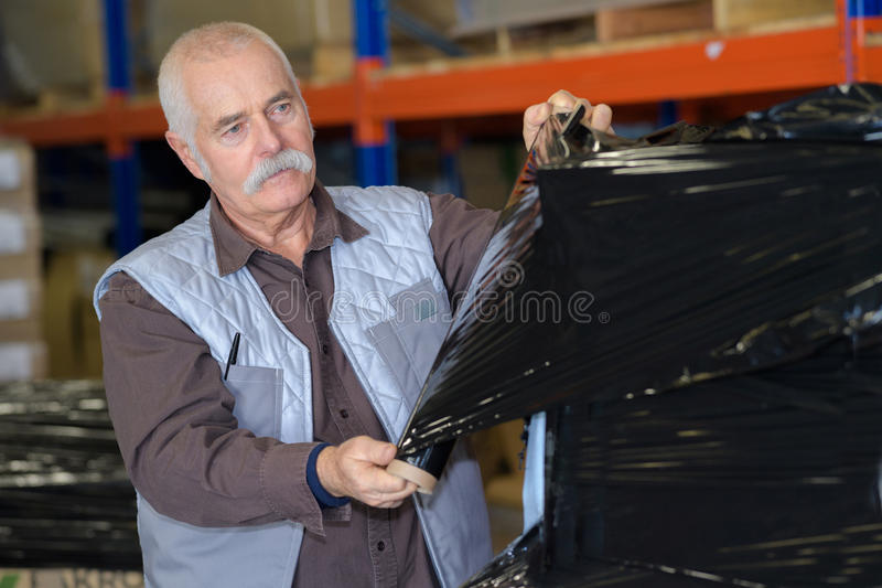 Man with bag packing stock photo