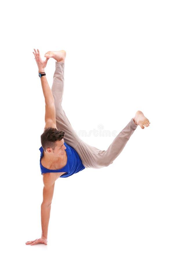 Man Balancing on One Hand stock photos
