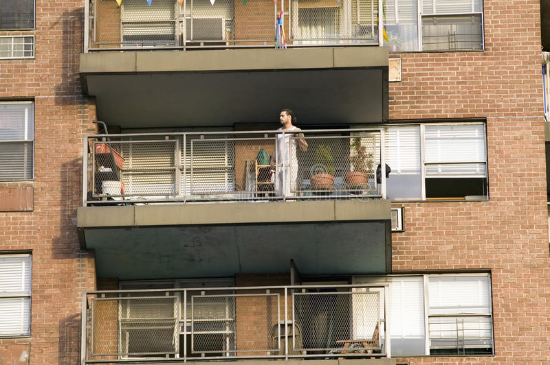Download Man on balcony in t-shirt editorial photo. Image of social - 25968586