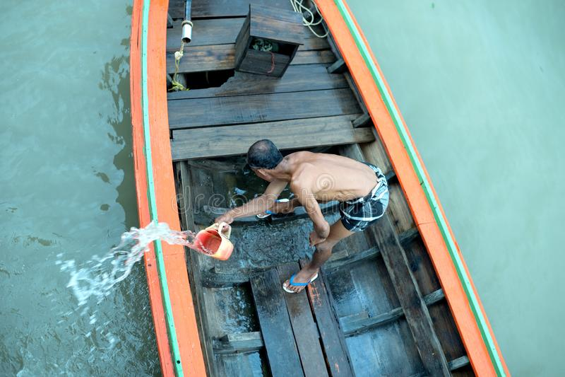 Man bales his boat. On one of the canals from south of thailand royalty free stock photography