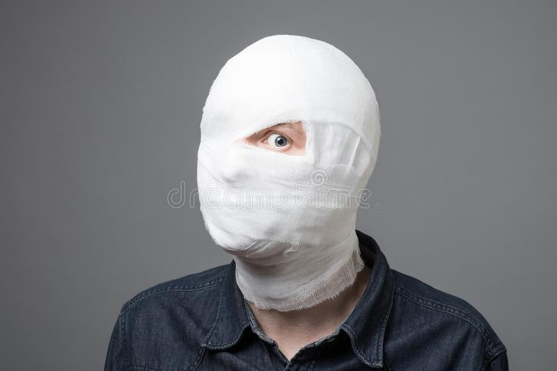 Man with bandage on his head royalty free stock images