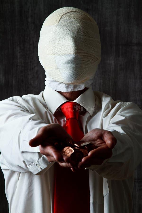 Man with bandaged face