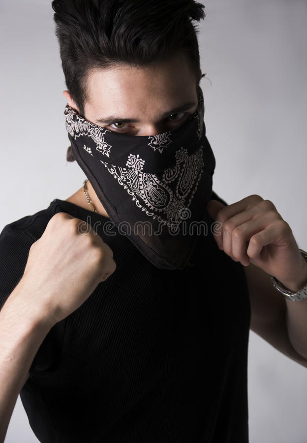 Man in a bandanna balling his fists aggressively stock image