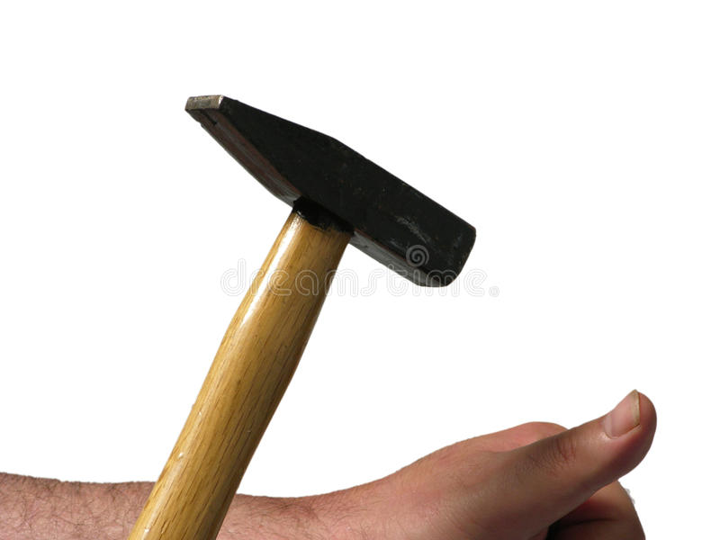 Man bangs with a hammer. On his thumb royalty free stock images