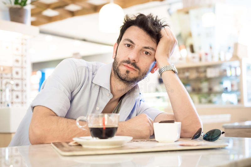 Man at the bar drinking coffee royalty free stock photography