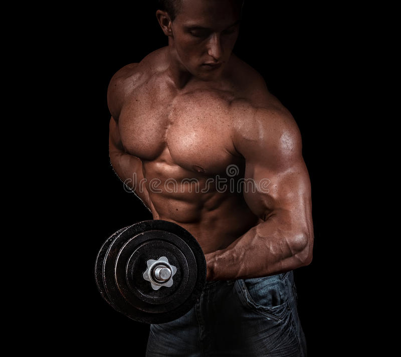 Man with a bar weights in hands training stock image