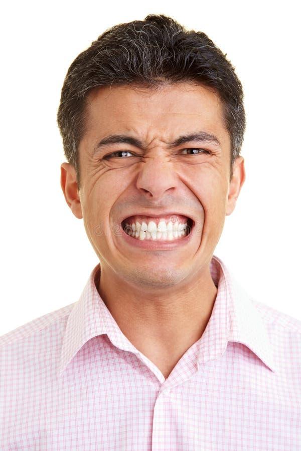 Man baring teeth. Man baring his teeth to the camera royalty free stock photo