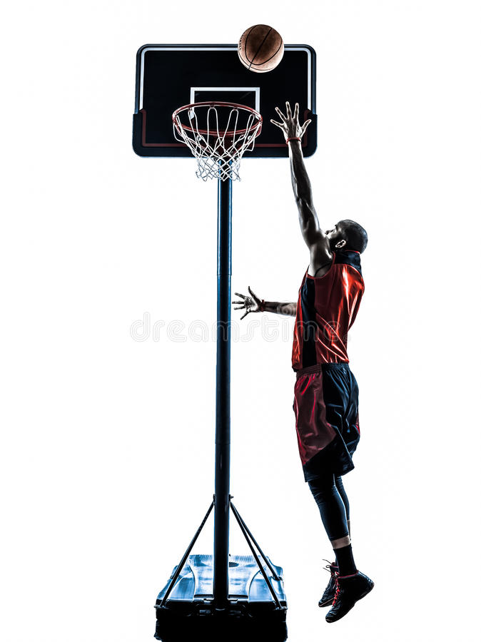 Man basketball player jumping throwing silhouette royalty free stock photography