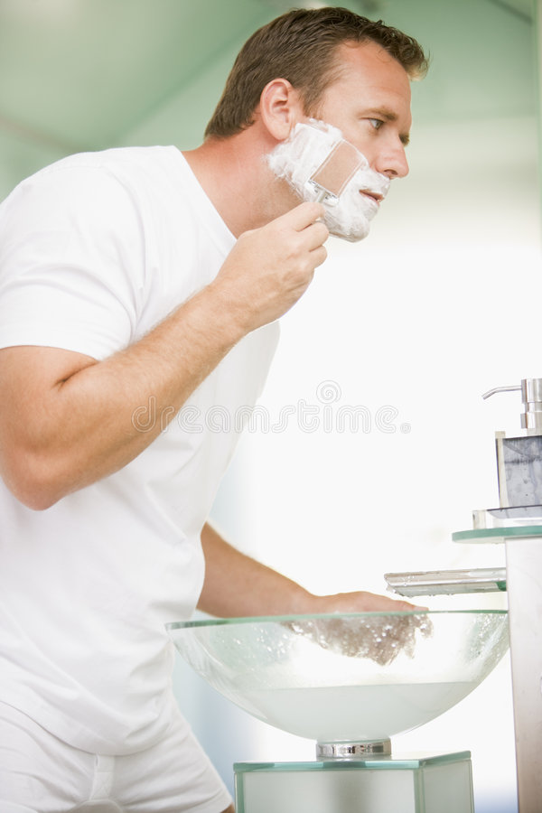 Download Man in bathroom shaving stock photo. Image of portrait - 5930588