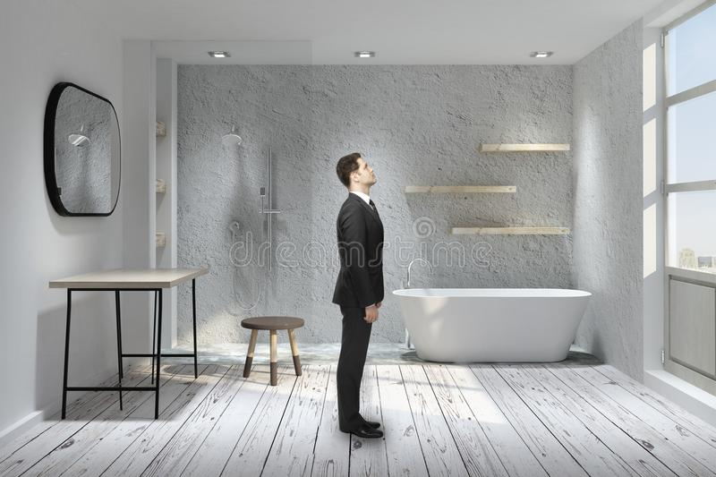 Man in bathroom. Side view of young man standing in modern bathroom interior. 3D Rendering royalty free stock photo