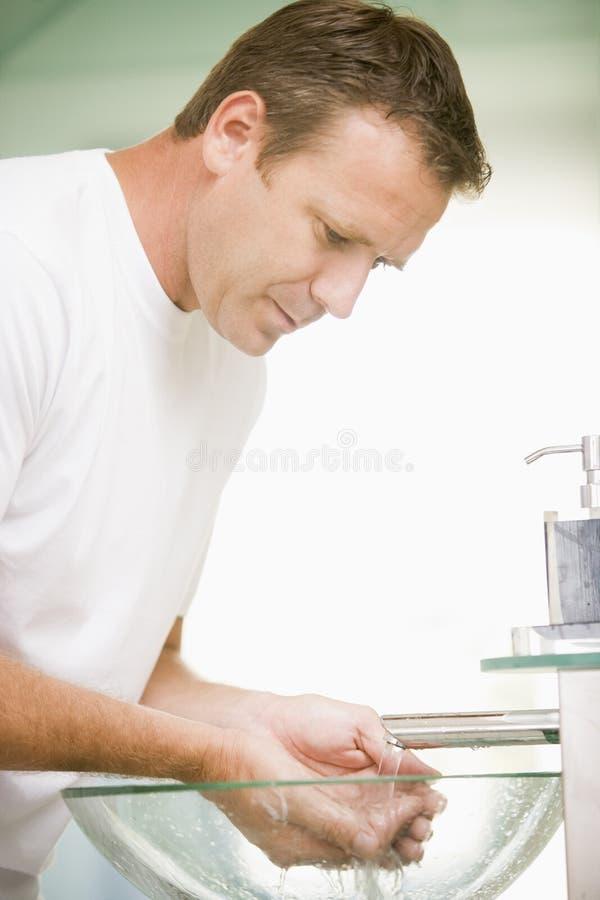 Download Man In Bathroom Washing Hands Stock Image - Image of handsome, indoors: 5930591