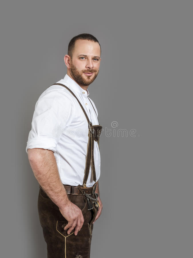 Man in bavarian traditional outfit for Oktoberfest. An image of a man in bavarian traditional outfit for Oktoberfest isolated on grey royalty free stock photography