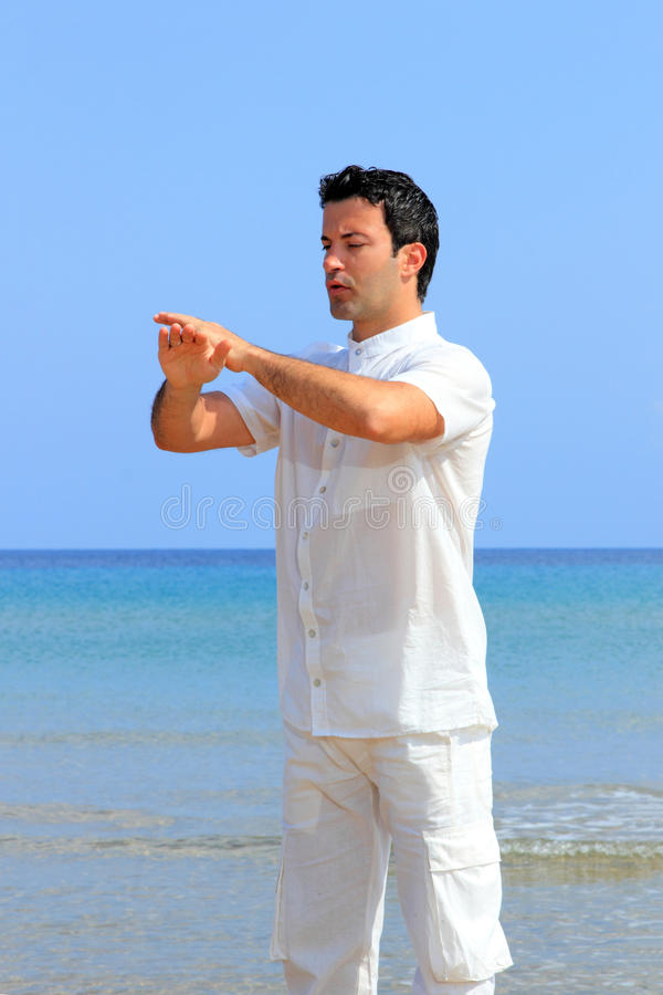 Download Man On The Beach Meditating Stock Image - Image: 24342087
