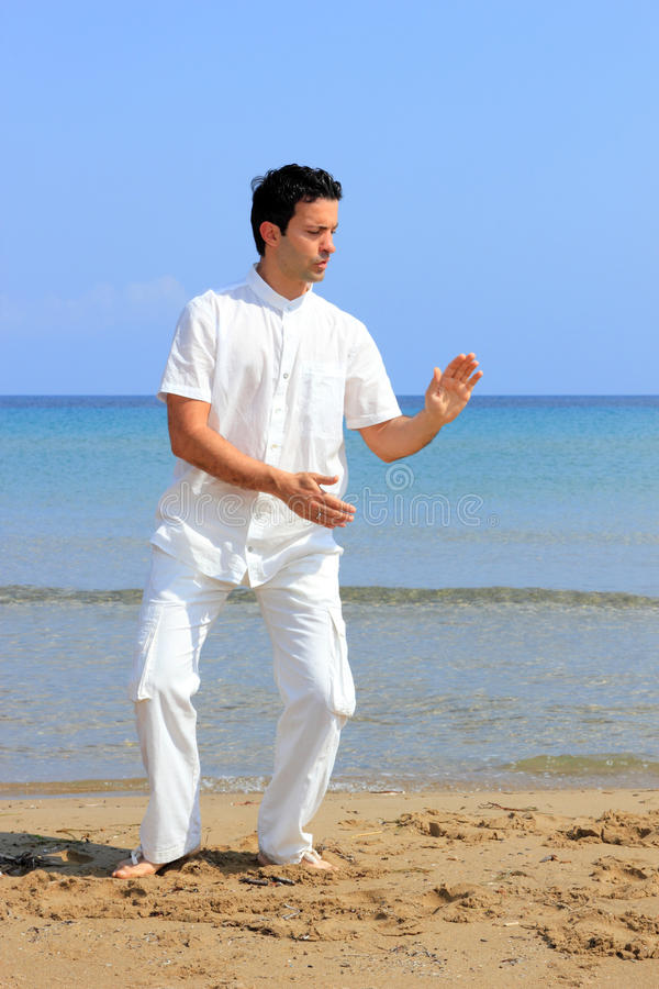 Download Man On The Beach Meditating Royalty Free Stock Photos - Image: 24342088