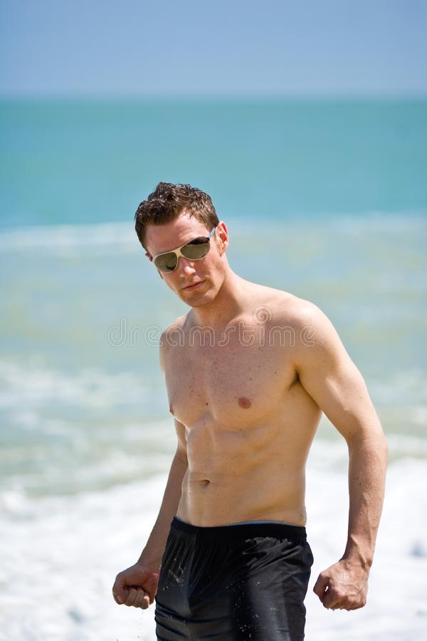 man at the beach with shades royalty free stock photos