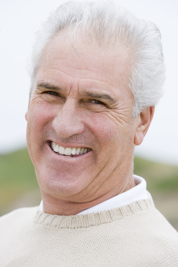 Download Man at the beach smiling stock photo. Image of pensioner - 5560902