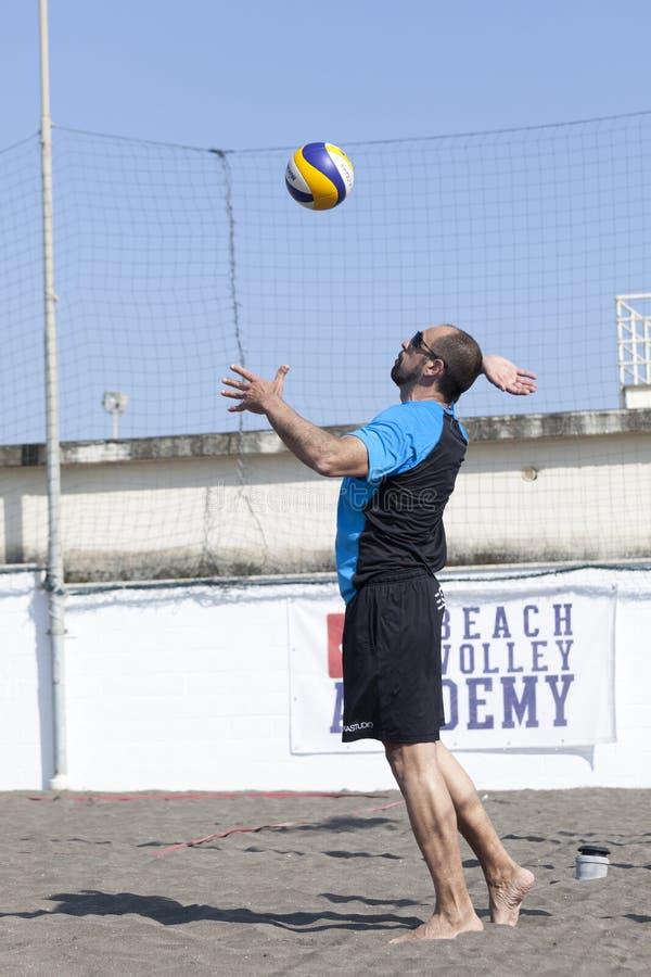 Man beach volleyball player serving ball. April 12, 2015. Beach Volleyball Tournament men. Location: Ostia (Hibiscus), Rome. Italy. A man beach volleyball player stock photography