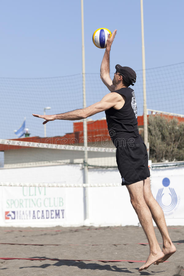 Man beach volleyball player serving ball jumping. April 12, 2015. Beach Volleyball Tournament men. Location: Ostia (Hibiscus), Rome. Italy. A man beach stock images