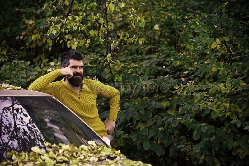 Man with beard at car. royalty free stock photography