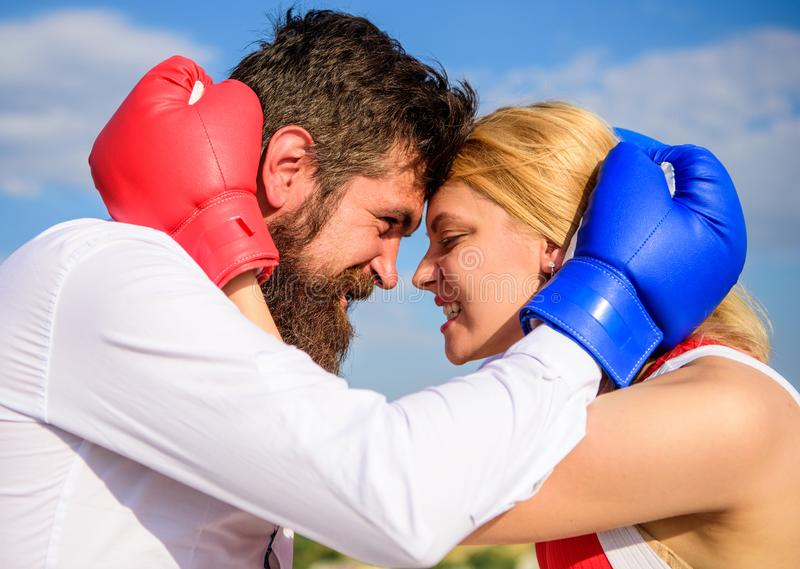 Man beard and girl cuddle happy after fight. Family life happiness and relation problems. Reconciliation and compromise. Fight for your happiness. Couple in royalty free stock image