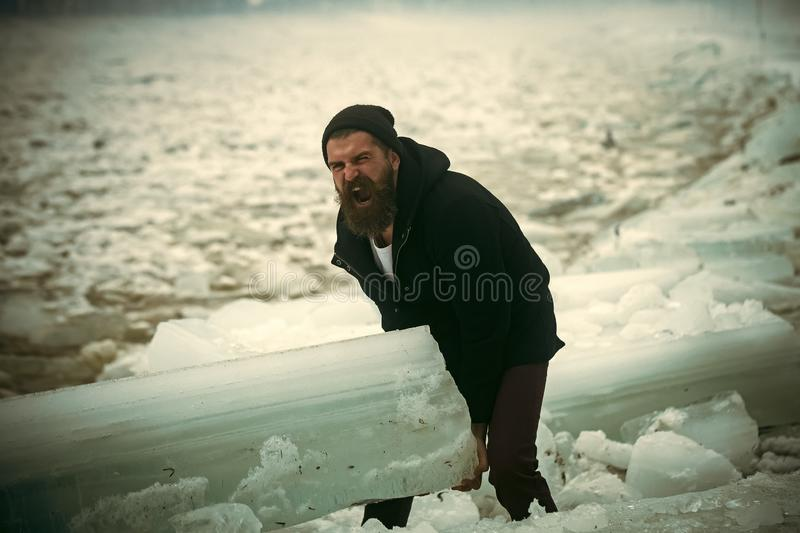 Man with beard hold big ice block. royalty free stock image