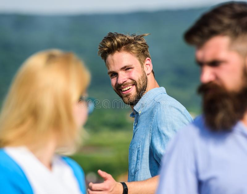 Man with beard jealous aggressive because girlfriend interested in handsome passerby. Husband strictly watching his wife royalty free stock photography