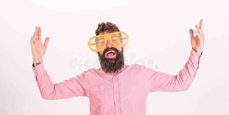 Man with beard and mustache on happy face wears funny big eyeglasses, white background. Cheerful mood concept. Hipster. Looking through of giant striped royalty free stock photos
