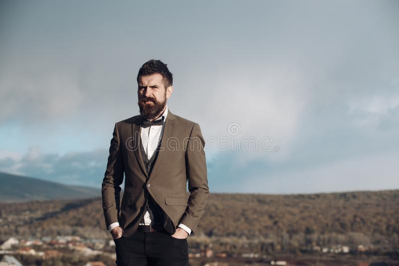 Man with beard and mustache with scenery on background. stock photo