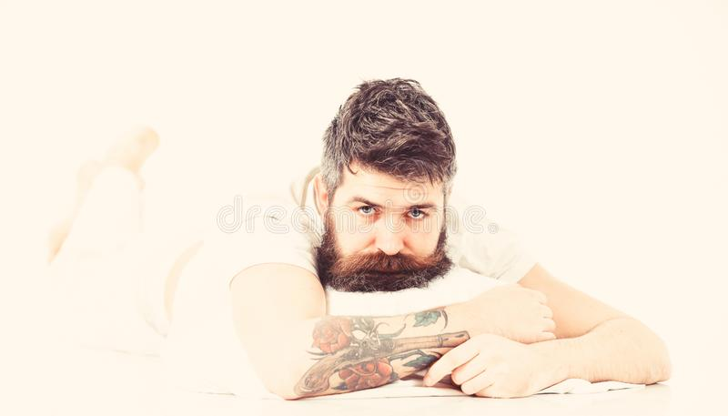 Man with beard and mustache tired, white background. Bad slept concept. Hipster drowsy, wants to sleep. Hipster with beard not slept well. Man with sleepy face stock image